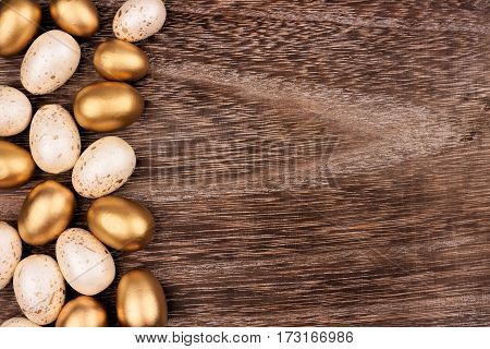 White And Gold Easter Egg Side Border Against A Rustic Wood Background