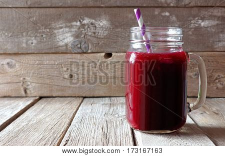 Healthy Beet Juice In A Mason A Jar Glass Over A Rustic Wood Background