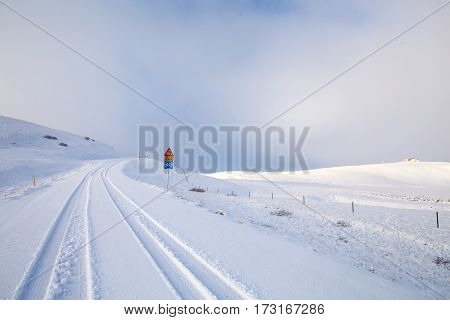 Winter snowy road in the mountains Iceland