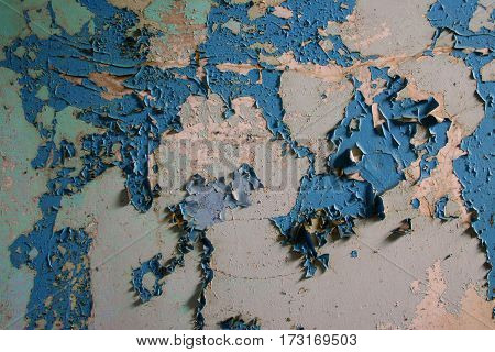 Wall with old paint in the shape of a world map