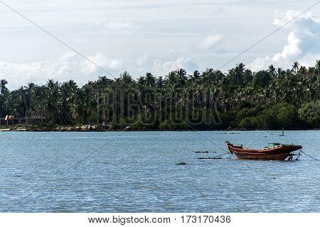 Long tail boat on the ocean in Koh Phangan Thailand