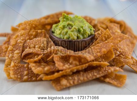 Angle View Bowl Of Guacamole And Chips
