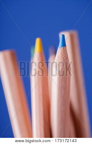 Macro view of crayons. Colored Pencils. Colored pencils on blue background. Art and design. Painting and drawing. School and education. Artist.