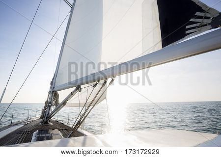 Yacht Sailing In Sea On Sunny Day