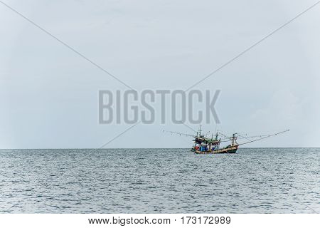 Fishing boat big fishermen with fish huge net on the blue ocean catching fish