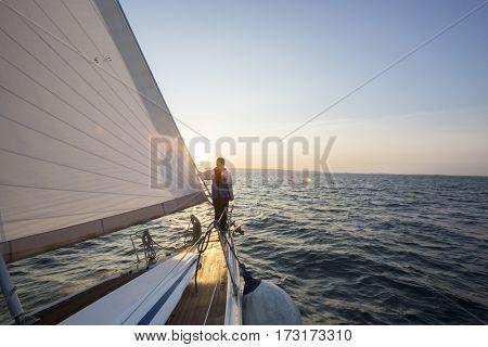 Man Looking At Beautiful Sea From Bow Of Sail Boat