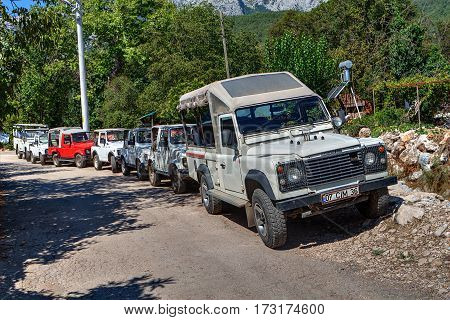 Kemer Antalya Turkey - august 26 2014: Jeep safari excursions tour at the Taurus mountains a plurality of wheel-drive vehicles parked by the side of a mountain road.