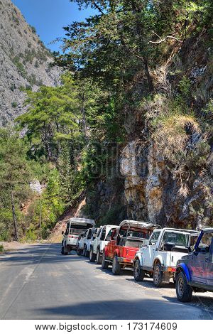 Kemer Antalya Turkey - august 26 2014: Sightseeing tour in the four wheel drive cars along mountain roads a lot of wheel-drive vehicles parked by the side of a rural road.