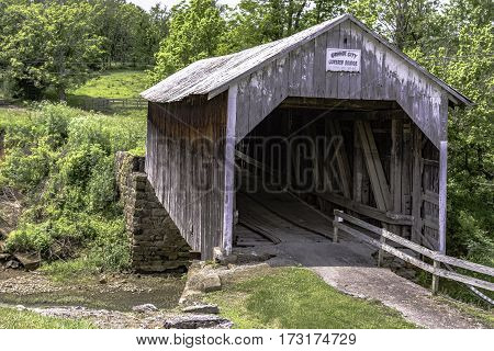 Flemingsburg Kentucky USA - May 26 2016: Grange City Covered Bridge built in 1805 spans Fox Creek. One of three covered bridges in Fleming County Kentucky.