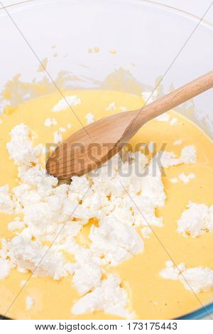 Mixed Whisked Eggs With Wire Isolated Over White