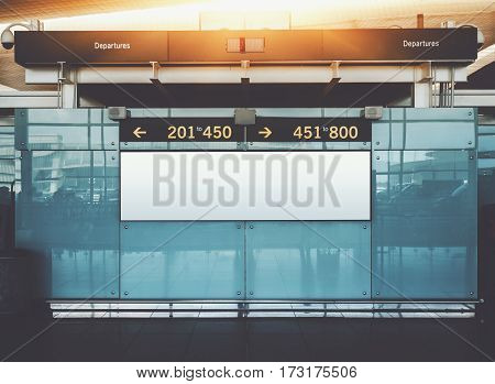 Blank electronic departures and arrival informational billboard with clean space for publicity content or text message narrow advertising mock up in interior public commercial board in airport hall