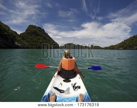 Young woman kayaking in beautiful Ang Thong National Marine Park, Thailand