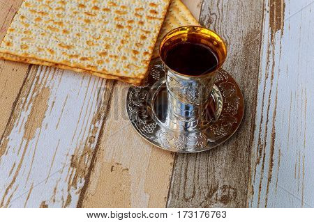 Passover Matzo With Kiddush Cup Wine On Wooden Table