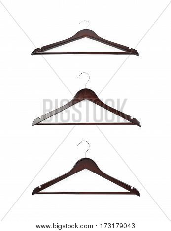 Single dark wooden hanger isolated over the white background, set of three different foreshortenings