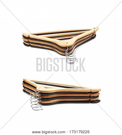 Pile of wooden hangers isolated over the white background, set of two different foreshortenings