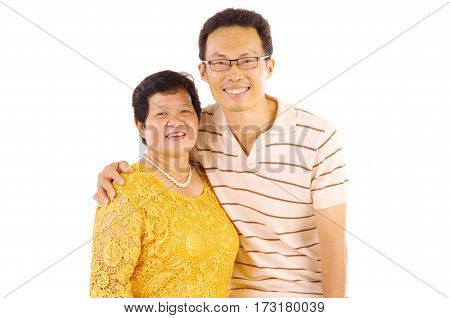 Asian mother and son. Happy Asian family mother and adult offspring having fun time at indoor studio.