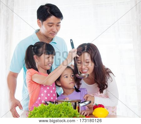 Asian family enjoy cooking in the kitchen