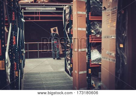 Storekeeper moving box on a warehouse