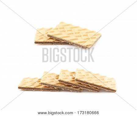 Pile of chocolate wafers isolated over the white background, set of two different foreshortenings