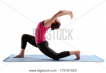 Sporty fit women practices yoga Anjaneyasana - low crescent lunge.