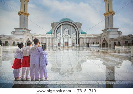 Muslim boy and Masjid Wilayah Persekutuan in Kuala Lumpur Malaysia