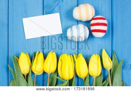 Fresh Tulips And Easter Eggs Wrapped Woolen String, Easter Decoration, Copy Space For Text On Sheet