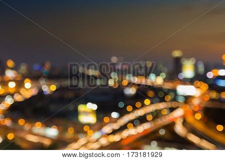 Blurred bokeh lights city highway intersection abstract background