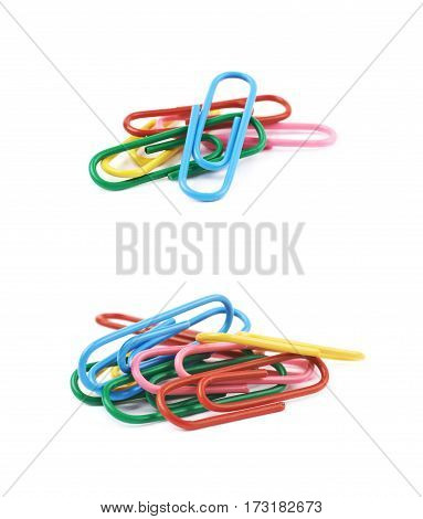 Pile of colorful office clips isolated over the white background, set of two different foreshortenings