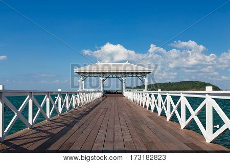 White wooden walkway leading to seacoast skyline natural landscape background