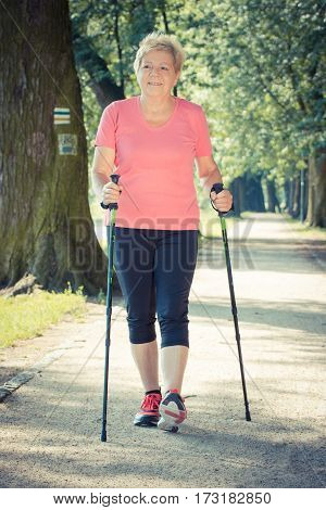 Vintage Photo, Elderly Senior Woman Practicing Nordic Walking, Sporty Lifestyles In Old Age