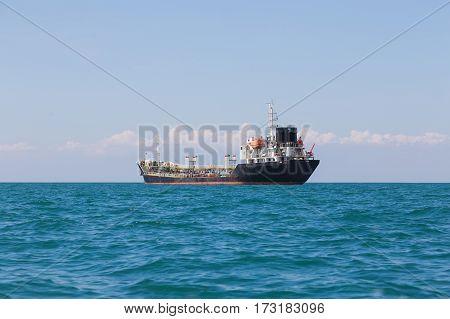 Transport ship over ocean seacoast skyline seascape background