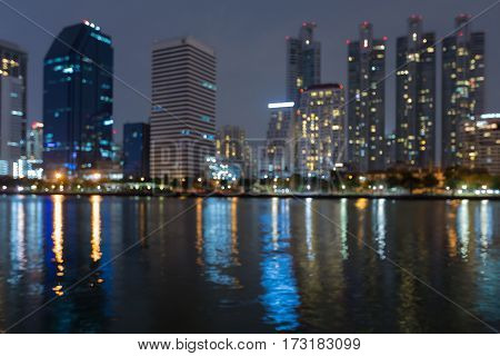 City office building and reflection blured lights night view abstract background