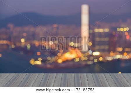 Opening wooden floor city blur light night view Hong Kong city over the bay abstract background