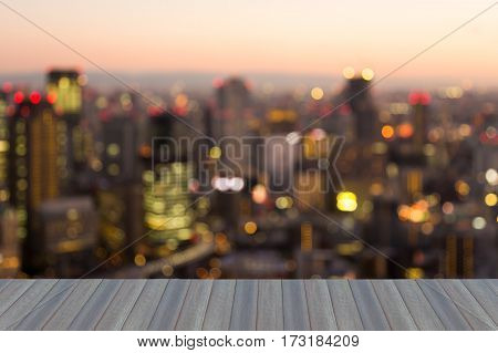 Opening wooden floor city of Osaka city blur light night view abstarct background