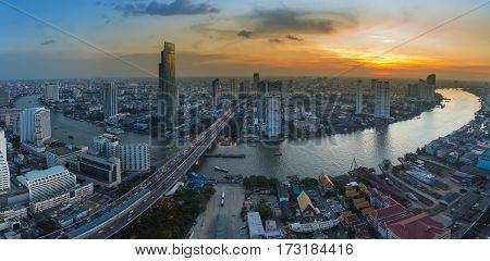 Panorama Bangkok city river curved with beautiful sunset skyline background cityscape background