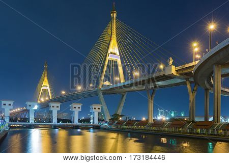 Twilight sky over Rama9 suspension bridge and watergate river front Bangkok Thailand