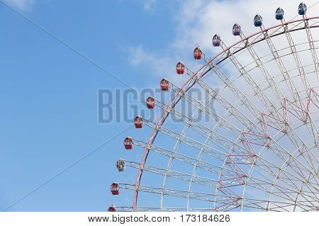 Path of big observation Ferris Wheel against blue sky background