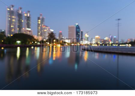 Reflection blur lights night view city office building abstract background