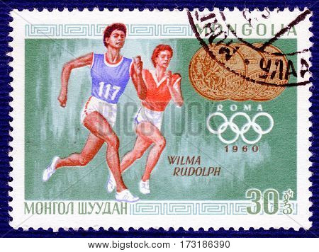 MONGOLIA - CIRCA 1960: Postage stamp printed in Mongolia  with a picture of Wilma Rudolph (Athletics), from the series
