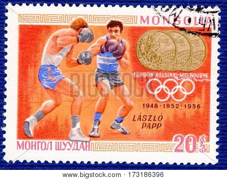 MONGOLIA - CIRCA 1960: Postage stamp printed in Mongolia  with a picture of Laszlo Papp (boxing), from the series