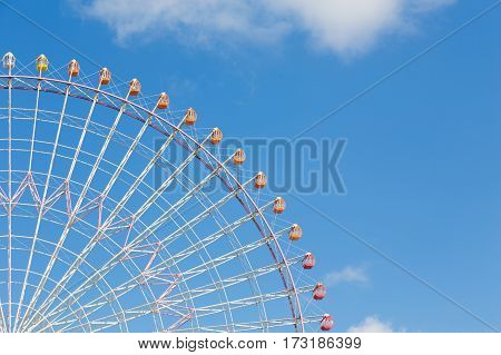 Observation Ferris Wheel against blue sky background