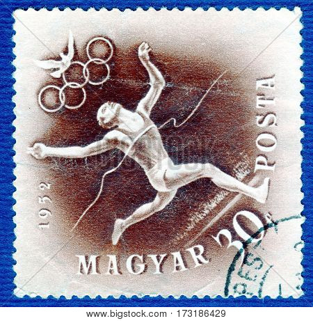 HUNGARY - CIRCA 1952: Postage stamp printed in Hungary  with a picture of a Athletics, from the series