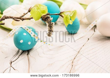 Easter decoration with eggs and green plants. Spring composition