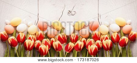 Easter decoration with tulips on wooden background