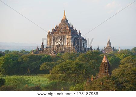 View of top of the ancient Buddhist temple Thatbyinnyu Phaya on the beginning of evening. Old Bagan. Myanmar