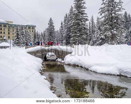 LAKE LOUISE, CANADA - FEB 19: Tourists enjoy the grounds at Chateau Lake Louise in Banff on February 19, 2017 in Alberta, Canada. Lake Louise is a famous summer and winter destination.
