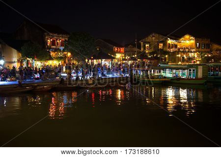 HOI AN, VIETNAM - JANUARY 02, 2016: Late evening on the embankment of the old city