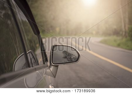 Car on the road in summer morning. vintage concept