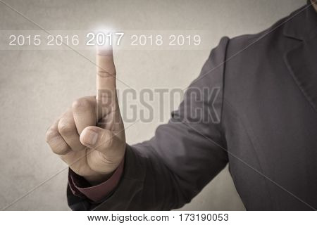 Businessman welcome year 2017. Business new year card concept / soft focus picture / Vintage concept