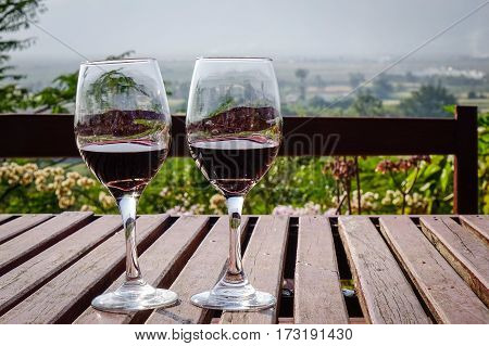 Glass Of Wine On The Wooden Table